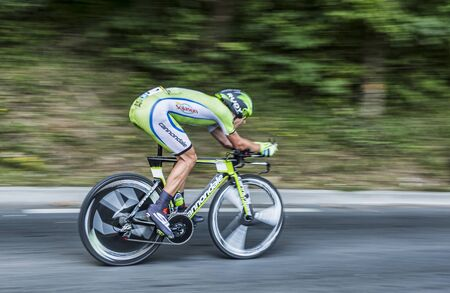 pedaling: Perigueux, France - July 26, 2014: Panning image of the Polish cyclist Maciej Bodnar  (CannondaleTeam) pedaling during the stage 20 ( time trial Bergerac - Perigueux) of Le Tour de France 2014.