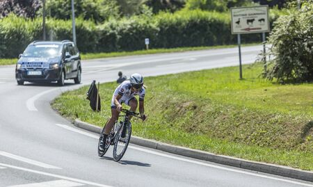 pedaling: Perigueux, France - July 26, 2014: Panning image of the French cyclist Florian Vachon (Bretagne-Seche Team) pedaling during the stage 20 ( time trial Bergerac - Perigueux) of Le Tour de France 2014. Editorial