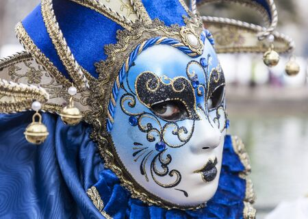 Annecy, France, February 23, 2013:Portrait of an unidentified person disguised posing in Annecy, France, during a Venetian Carnival which is held yearly to celebrate the beauty of the real Venice. Editorial
