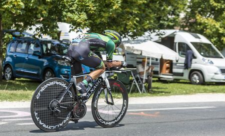 pedaling: Coulounieix-Chamiers, France - July 26, 2014: Panning image of the French cyclist Bryan Coquard (Europcar Team) pedaling during the stage 20 ( time trial Bergerac - Perigueux) of Le Tour de France 2014.