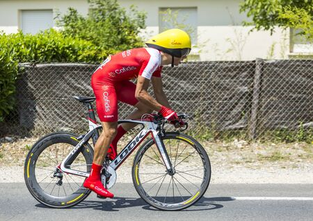 pedaling: Coulounieix-Chamiers, France - July 26, 2014: The French cyclist Julien Simon (Cofidis Team) pedaling during the stage 20 ( time trial Bergerac - Perigueux) of Le Tour de France 2014. Editorial