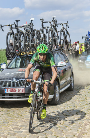 arbre: CAMPHIN EN PEVELE,FRANCE-APR 13:The cyclist Alexandre Pichot from Team Europcar riding on the cobblestone sector Carrefour de Arbre in Camphin-en-Pevele on April 13 2014 during Paris-Roubaix race