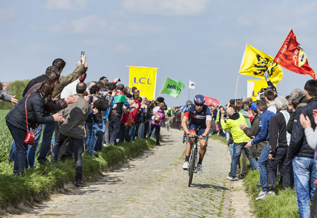 arbre: CAMPHIN EN PEVELE,FRANCE-APR 13:The cyclist Roger Kluge from Team IAM Cycling riding on the cobblestone sector Carrefour de Arbre in Camphin-en-Pevele on April 13 2014 during Paris-Roubaix race