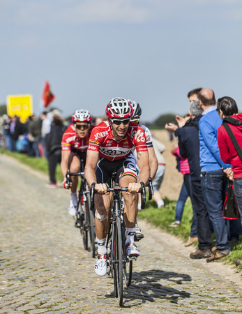 arbre: CAMPHIN EN PEVELE,FRANCE-APR 13:The cyclist Kenny Dehaes from Lotto-Belisol Team riding on the cobblestone sector Carrefour de Arbre in Camphin-en-Pevele on April 13 2014 during Paris-Roubaix race