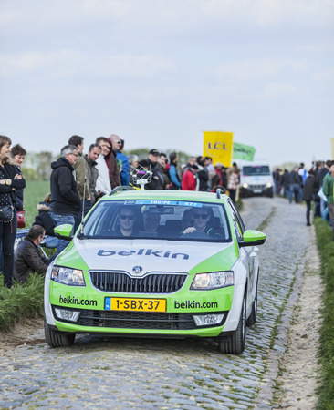 arbre: CAMPHIN EN PEVELE,FRANCE-APR 13:The official car of Belkin team driving on the cobblestone sector Carrefour de Arbre in Camphin-en-Pevele on April 13 2014 during Paris-Roubaix race