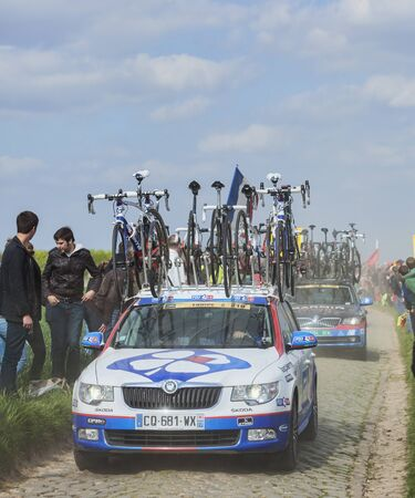 arbre: CAMPHIN EN PEVELE,FRANCE-APR 13:The car of FDJ.fr team carrying spare bicycles on the cobblestone sector Carrefour de lArbre in Camphin-en-Pevele on April 13 2014 during Paris-Roubaix cycling race