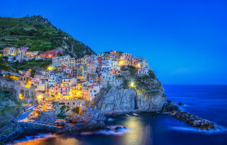 Beautiful evening view of the Manarola village from the famous Cinque Terre on the Italian Riviera. photo