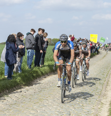 arbre: CAMPHIN EN PEVELE,FRANCE-APR 13:The Slovenian cyclist Blaz Jarc from NetApp-Endura riding on the cobblestone sector Carrefour de Arbre in Camphin-en-Pevele on April 13 2014 during Paris-Roubaix Editorial