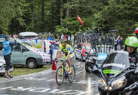 daniele: Le Markstein, France- July 13, 2014: The Italian cyclist Daniele Bennati of Team Tinkoff-Saxo and technical cars climbing the road to mountain pass Le Markstein in Vosges mountains during the stage 9 of Le Tour de France 2014.