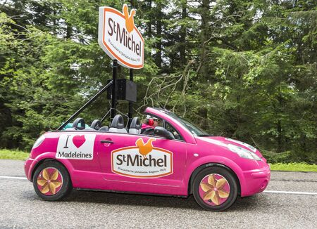 publicity: Col de Platzerwasel, France - July 14, 2014: Fancy vehicle of St. Michel Madeleines passing in the Publicity Caravan on the road to mountain pass Platzerwasel, in Vosges Mountains during the stage 10 of Le Tour de France on 23 July 2014.Senseo is a regist Editorial