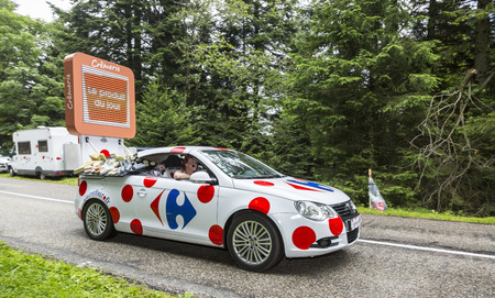 carrefour: Col de Platzerwasel, France - July 14, 2014:Car of Carrefour advertising the product of the day during the passing of the advertising caravan on the road to route to the mountain pass Platzerwasel during the stage 10 of Le Tour de France 2014.