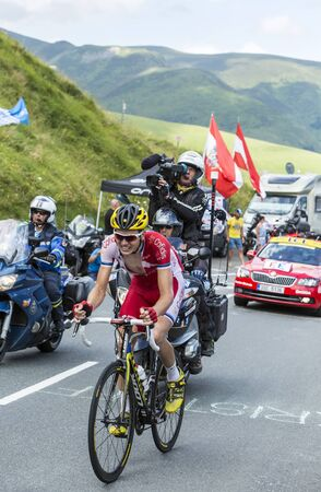 rein: Col de Peyresourde,France- July 23, 2014: The Estonian cyclist Rein Taaramae (Team  Cofidis) climbing the road to Col de Peyresourde in Pyrenees Mountains during the stage 17 of Le Tour de France on 23 July 2014. Editorial
