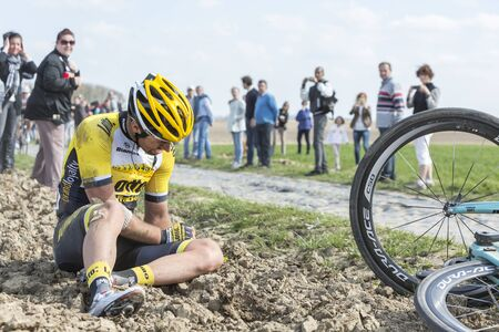 continued: Carrefour de lArbre,France - April 12,2015: The Belgian cyclist Tom Van Asbroeck of LottoNL-Jumbo Team crashed at high speed in the difficult sector Carrefour de lArbre during the Paris Roubaix 2015 race. He continued and finished the race.