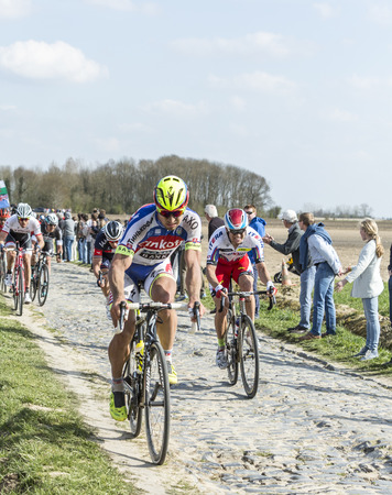 rou: Carrefour de lArbre,France - April 12,2015: The Slovak cyclist Peter Sagan of Tinkoff-Saxo Team, and the Norwegian cyclist Alexander Kristoff of Team Katusha,riding in the peloton on the famous cobblesoned sector Carrefour de lArbre during the Paris Rou Editorial