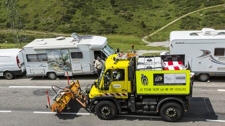 overheating: Col du Tourmalet France  24 July 2014: Technical truck which assure the good status of the roads cleanliness and preventing overheating is passing before the cyclists on the road to Col de Tourmalet in the stage 18 of Le Tour de France on 24 July 2014.