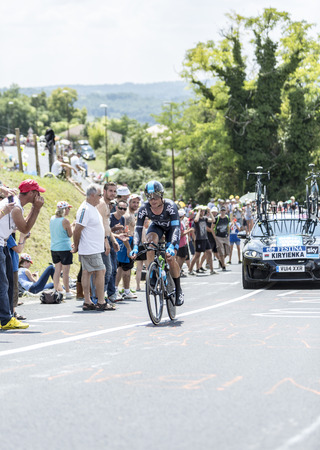 Cote de CoulounieixChamiers France  July 26 2014: The Belarusian cyclist Vasili Kiryienka Team Sky pedaling  on a steep slope in front of spectators during the stage 20  time trial Bergerac  Perigueux of Le Tour de France 2014.