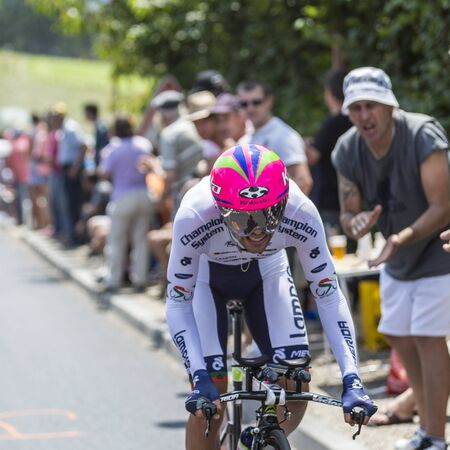 pedaling: Cote de CoulounieixChamiers France  July 26 2014: The Portuguese cyclist Nelson Oliveira LampreMerida Team pedaling  on a steep slope in front of spectators during the stage 20  time trial Bergerac  Perigueux of Le Tour de France 2014.