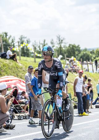 pedaling: Cote de CoulounieixChamiers France  July 26 2014: The Belarusian cyclist Vasili Kiryienka Team Sky pedaling  on a steep slope in front of spectators during the stage 20  time trial Bergerac  Perigueux of Le Tour de France 2014.