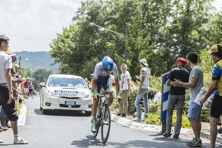 pedaling: Coulounieix Chamiers France  July 26 2014:The Belgian cyclist Jens Keukeleire Orica Green EDGE Team pedaling during the stage 20  time trial Bergerac  Perigueux of Le Tour de France 2014. Editorial