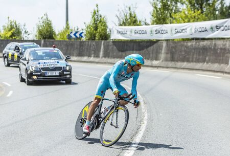 pedaling: Coursac France  July 26 2014: The Italian cyclist Michele Scarponi AstanaTeam pedaling  on a steep slope in front of spectators during the stage 20  time trial Bergerac  Perigueux of Le Tour de France 2014.
