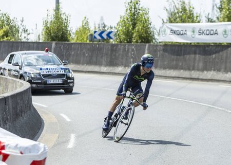 pedaling: Coursac France  July 26 2014: The Italian cyclist Giovanni Visconti  Movistar Team pedaling during the stage 20  time trial Bergerac  Perigueux of Le Tour de France 2014.