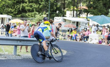 Coursac France  July 26 2014: The Irish cyclist Nicolas Roche Tinkoff Saxo Team pedaling in front of exciting spectators during the stage 20  time trial Bergerac  Perigueux of Le Tour de France 2014.