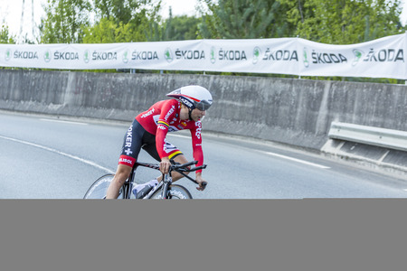 pedaling: Coursac France  July 26 2014: The French cyclist Tony Gallopin  LottoBelisolTeam pedaling  on a steep slope in front of spectators during the stage 20  time trial Bergerac  Perigueux of Le Tour de France 2014.