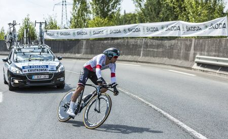 pedaling: Coursac France  July 26 2014: The Polish cyclist Michal Kwiatkowski Omega PharmaQuick Step Team pedaling  on a steep slope in front of spectators during the stage 20  time trial Bergerac  Perigueux of Le Tour de France 2014. Editorial