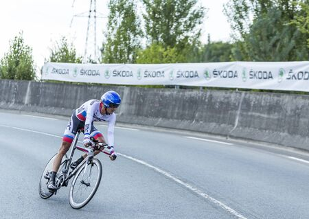pedaling: Coursac France  July 26 2014: The Slovak cyclist Peter Velits  BMC RacingTeam pedaling  on a steep slope in front of spectators during the stage 20  time trial Bergerac  Perigueux of Le Tour de France 2014.