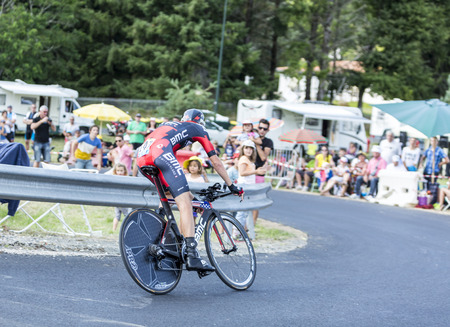 pedaling: Coursac France  July 26 2014: The American cyclist Peter Stetina  BMC RacingTeam pedaling  on a steep slope in front of spectators during the stage 20  time trial Bergerac  Perigueux of Le Tour de France 2014.