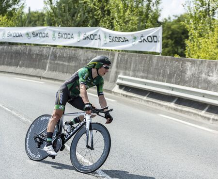 pedaling: Coursac France  July 26 2014: The French cyclist Cyril Gautier  Europcar Team pedaling during the stage 20  time trial Bergerac  Perigueux of Le Tour de France 2014.