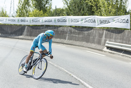 pedaling: Coursac France  July 26 2014: The Estonian cyclist Tanel Kangert AstanaTeam pedaling  during the stage 20  time trial Bergerac  Perigueux of Le Tour de France 2014. Editorial