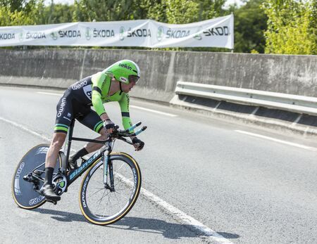 pedaling: Coursac France  July 26 2014: The Dutch cyclist Steven Kruijswijk  Belkin Pro CyclingTeam pedaling  during the stage 20  time trial Bergerac  Perigueux of Le Tour de France 2014. Editorial