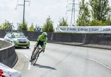 pedaling: Coursac France  July 26 2014: The Dutch cyclist Bauke Mollema  Belkin Pro CyclingTeam pedaling  during the stage 20  time trial Bergerac  Perigueux of Le Tour de France 2014.