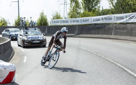 pedaling: Coursac France  July 26 2014: The French cyclist Romain Bardet Ag2rLa Mondiale Team pedaling during the stage 20  time trial Bergerac  Perigueux of Le Tour de France 2014.