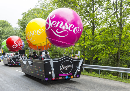 bystanders: Le Markstein, France- July 13, 2014: Fancy vehicles of Senseo during the passing of the publicity caravan on the road to the mountain pass Le Markstein during the stage 9 of Le Tour de France 2014.Senseo is a registered trademark for a coffee brewing syst Editorial