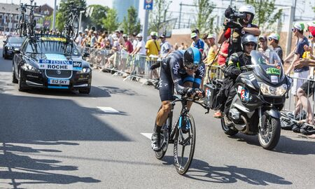bystanders: Utrecht,Netherlands - 04 July 2015: The Irish cyclist Nicolas Roche of Team Sky riding during the first stage individual time trial  of Le Tour de France 2015 in Utrecht,Netherlands on 04 July 2015. Editorial