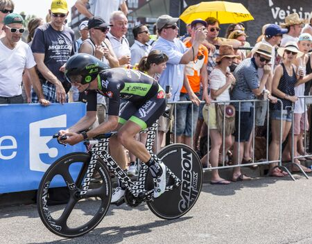 bystanders: Utrecht,Netherlands - 04 July 2015: The French clist Pierre-Luc Perichon of Bretagne-Seche Environnement Team riding during the first stage individual time trial  of Le Tour de France 2015 in Utrecht,Netherlands on 04 July 2015.