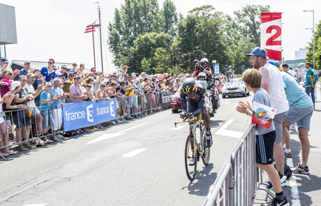 bystanders: Utrecht,Netherlands - 04 July 2015: The cyclist Daniel Teklehaimanot, from Eritrea, of MTN-Qhubeka Team riding during the first stage individual time trial  of Le Tour de France 2015 in Utrecht,Netherlands on 04 July 2015.