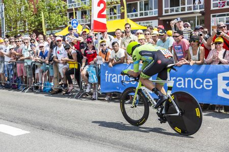 bystanders: Utrecht,Netherlands - 04 July 2015: The New Zealander cyclist Jack Bauer of Cannondale-Garmin Team riding during the first stage individual time trial  of Le Tour de France 2015 in Utrecht,Netherlands on 04 July 2015.