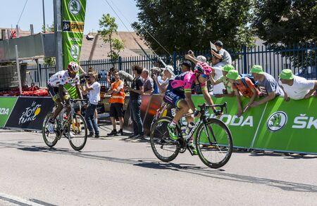intermediate: Argentan, France - July 10, 2015: Kristijan Durasek of Lampre Merida Team and Daniel Teklehaimanot of MTN-Qhubeka Team, part of the breakaway,crossing the line of the intermediate sprint in Argentan during Tour de France on 10 July 2015.