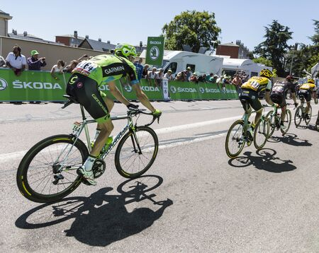 intermediate: Argentan, France - July 10, 2015: Ryder Hesjedal of Cannondale-Garmin Team riding in the peloton after crossing the line of the intermediate sprint in Argentan during Tour de France on 10 July 2015. Editorial