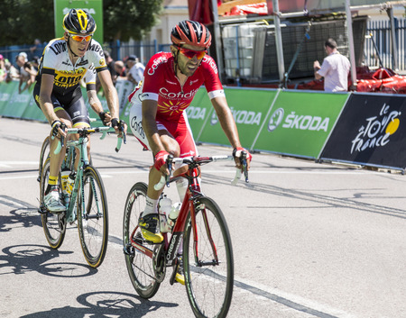 bystanders: Argentan, France - July 10, 2015: The Dutch cyclist Robert Gesink of LottoNL-Jumbo Team and the Spanish cyclist Daniel Navarro Garcia of Cofidis Team riding in the peloton after crossing the line of the intermediate sprint in Argentan during Tour de Franc