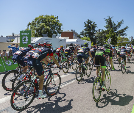 intermediate: Argentan, France - July 10, 2015: The peloton riding after crossing the line of the intermediate sprint in Argentan during Tour de France on 10 July 2015.