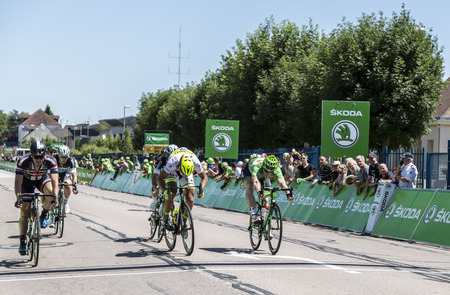 intermediate: Argentan, France - July 10, 2015: John Degenkolb Giant Alpecin, Peter Sagan Tinkoff-Saxo and Andre Greipel Lotto-Soudal fight for points at the intermediate sprint in Argentan during Tour de France on 10 July 2015.