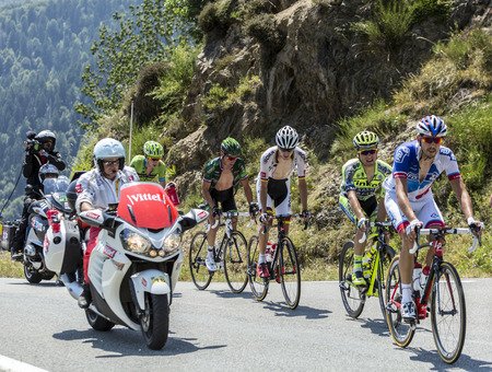 breakaway: Col DAspin,France- July 15,2015: The breakaway climbing the road to Col DAspin  in Pyrenees Mountains during the stage 11 of Le Tour de France 2015.