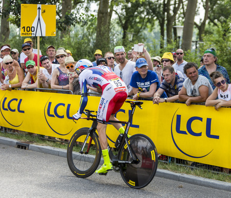 bystanders: Utrecht,Netherlands - 04 July 2015: The Russian cyclist Dmitry Kozonchuk of Katusha Team riding during the first stage individual time trial  of Le Tour de France 2015 in Utrecht,Netherlands on 04 July 2015. Editorial