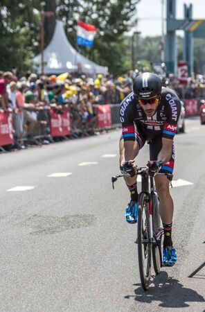 bystanders: Utrecht,Netherlands - 04 July 2015: The Dutch cyclist Roy Curvers of Giant-Alpecin Team riding during the first stage individual time trial  of Le Tour de France 2015 in Utrecht,Netherlands on 04 July 2015.