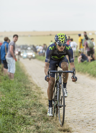 gomez: Quievy,France - July 07, 2015: The Colombian cyclist Anacona Gomez of Movistar Team riding on a cobblestoned road during the stage 4 of Le Tour de France 2015 in Quievy, France, on 07 July,2015. Editorial