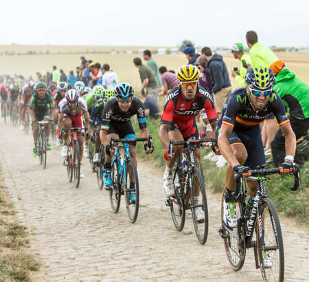 manuel: Quievy,France - July 07, 2015: Alejandro Valverde Movistar Team and Manuel Quinziato BMC Team riding in front of a cyclists on cobblestoned road during the stage 4 of Le Tour de France 2015 in Quievy, France, on 07 July,2015. Editorial
